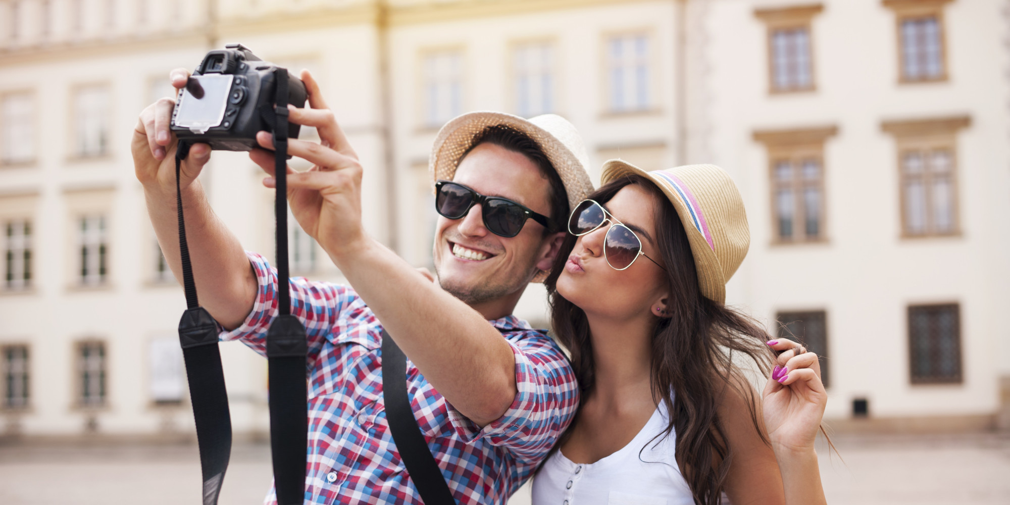 Happy tourists taking photo of themselves