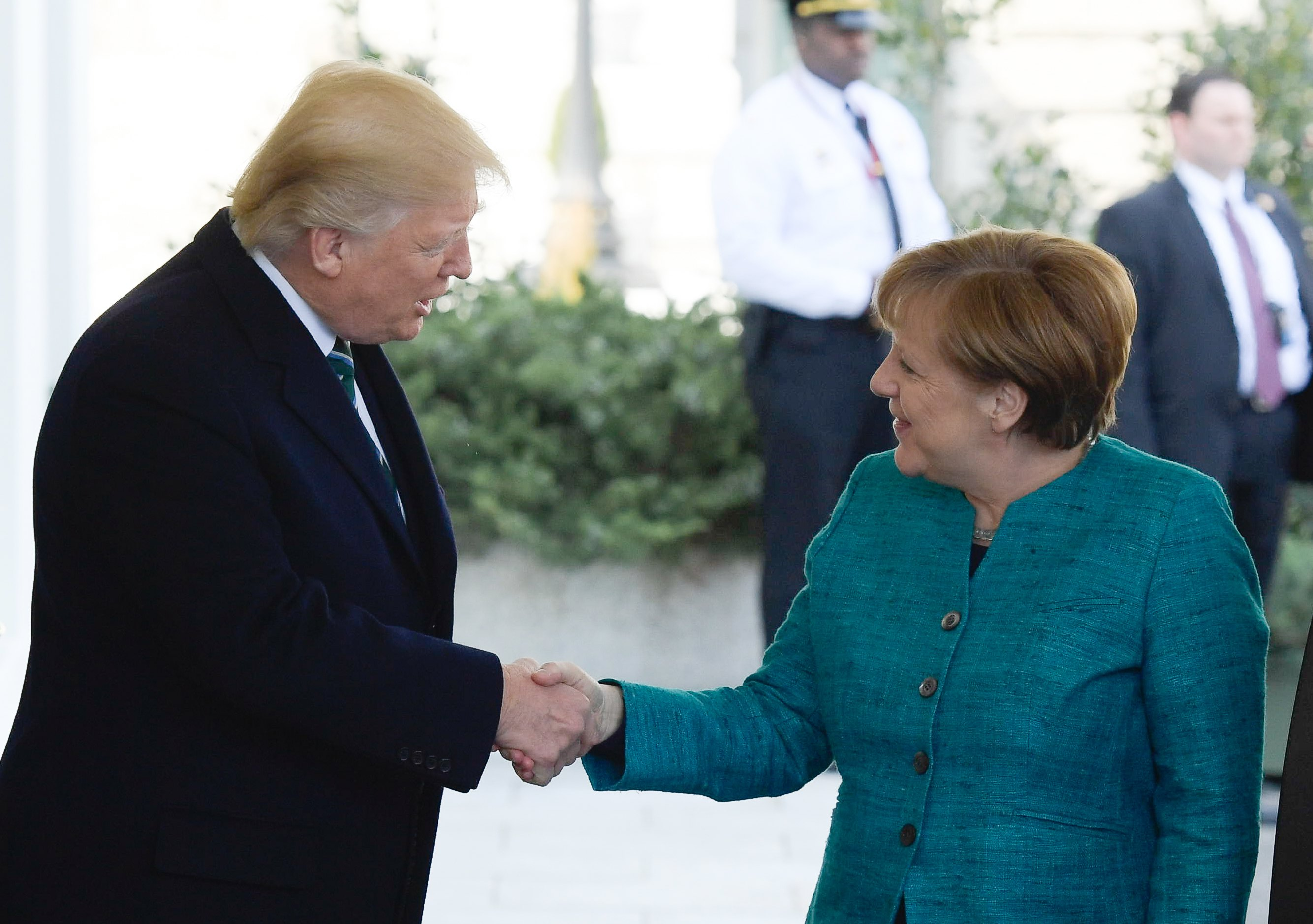 epa05854386 US President Donald J. Trump (L) welcomes German Chancellor Angela Merkel at the White House in Washington, DC, USA, 17 March 2017. Merkel's original visit on 14 March had to be postponed due to bad weather.  EPA/CLEMENS BILAN