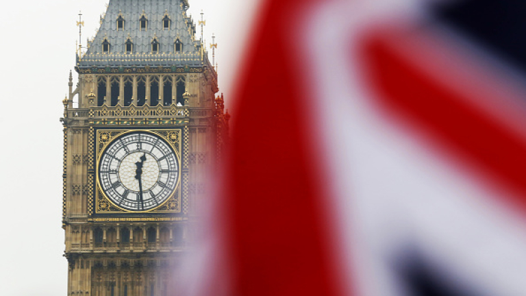 A Union Flag, also known as Union Jack, flies in front of Elizabeth Tower, commonly referred to as Big Ben, in London, U.K., on Wednesday, Jan. 25, 2017. U.K. Prime Minister Theresa May said she'll publish her plan for Brexit, giving in to demands from lawmakers seeking greater scrutiny in Parliament. Photographer: Luke MacGregor/Bloomberg via Getty Images