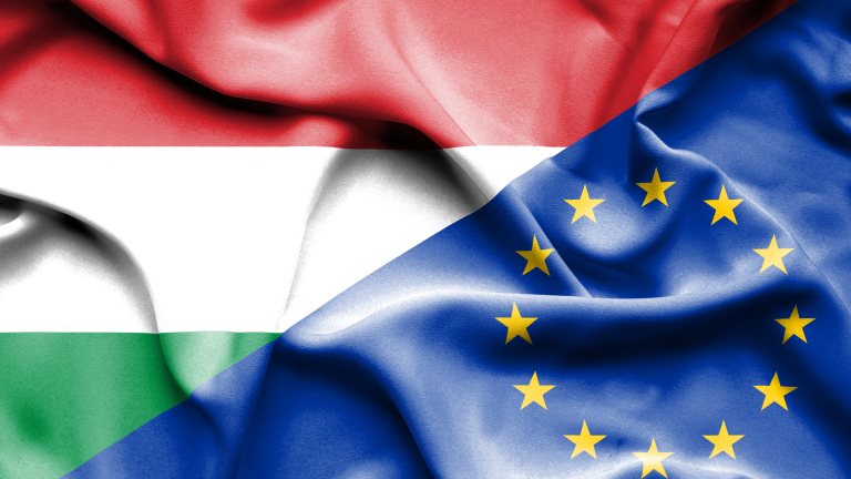 Waving flag of European Union and Hungary