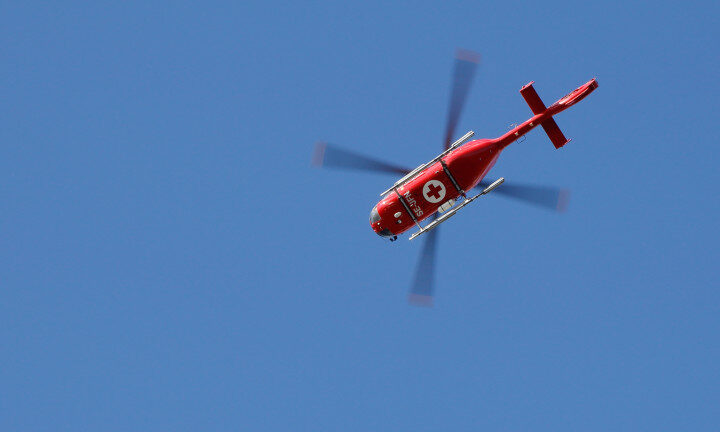 Stockholm, Sweden - July 7, 2016: One helicopter air ambulance Eurocopter EC135 (SE-JFN) operated by Scandinavian Medicopter  in the air near the Sodersjukhuset hospital
