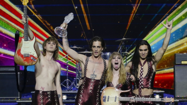 Members of the band Maneskin from Italy guitarist Thomas Raggi, from left, lead vocalist Damiano David, bass player Victoria De Angelis and drummer Ethan Torchio, pose for photographers with the trophy after winning the Grand Final of the Eurovision Song Contest at Ahoy arena in Rotterdam, early Sunday, May 23, 2021. (AP Photo/Peter Dejong)